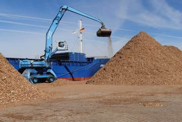Photo: An excavator carries a mountain of wood chips